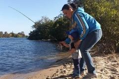 Boy's 1st fishing trip. Dad moment.