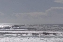 Surfer Paradise beach while cyclone brewing offshore