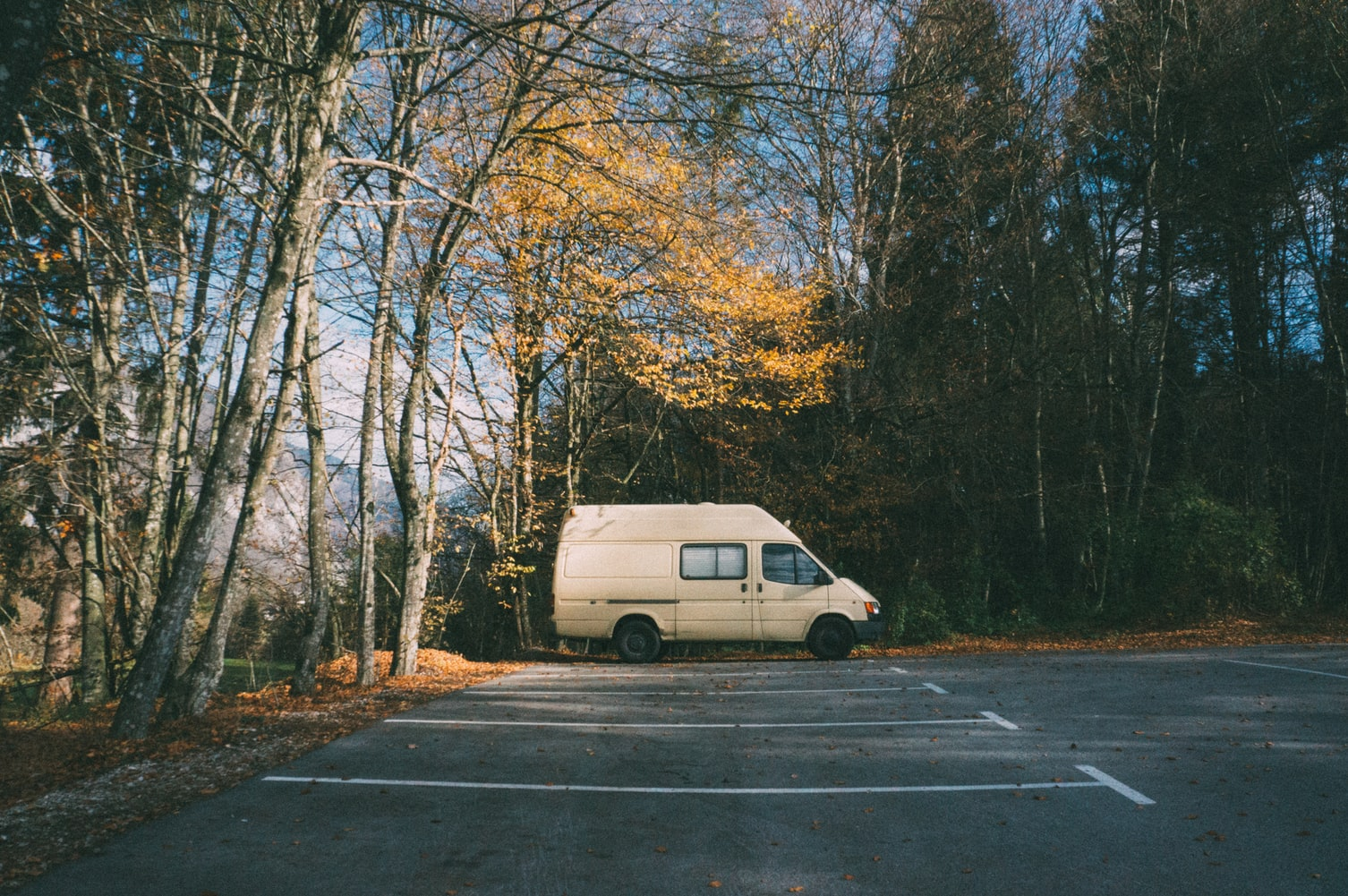 Single camper van parked in an empty parking lot