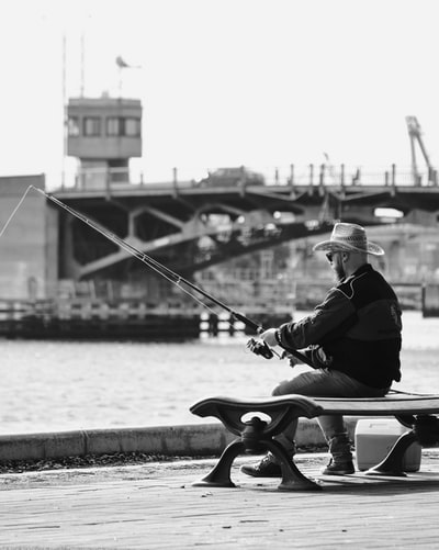 solo man fishing from a pier